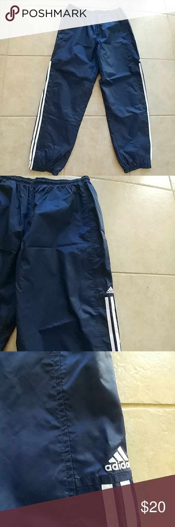 EUC Adidas Vintage Wind Suit Pants Adidas Vintage Navy Blue Pants w Three White Stripes. They Have a Mesh Lining until the Knee then See Picture 7. Side Pockets and Zipper at the Ankles. Outside and Lower Lining is 100% Nylon. Upper inside is 100% Polyester. adidas Pants Sweatpants & Joggers