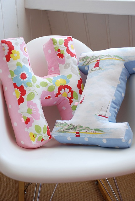 Inspiration for potential crafty shenanigans - pillows in the shapes of letters.