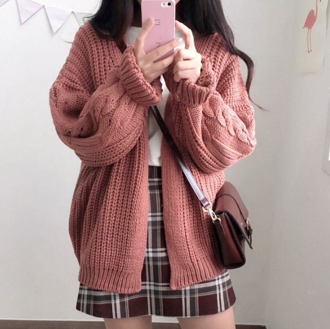 The chunky cardigan and plaid skirt are perfection