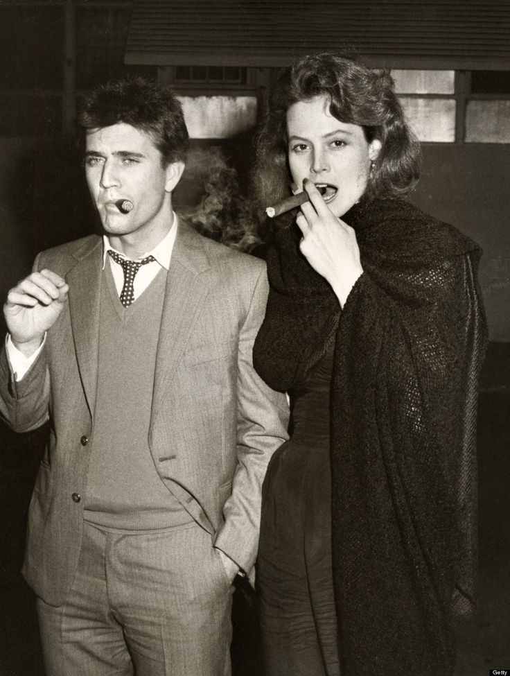 Mel Gibson and Sigourney Weaver - cigars in 1983