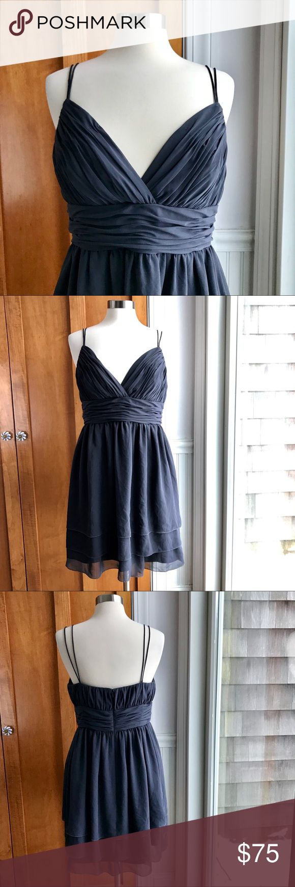 """Calvin Klein gray evening dress w/tiered skirt EUC- No flaws to note. 100% polyester. Fully lined. Gathered Grecian-like design.  SO pretty and flattering!!  Double spaghetti straps.  Crossover v-neck bodice.  Fitted waist.  Triple layered flowing skirt.  Back zip. Approximate measurements taken with garment laying flat: underarm to underarm 18"""", waist 16"""", hips 26"""", shoulder seam to waist 14"""", shoulder seam to hem 37"""". Calvin Klein Dresses Midi"""