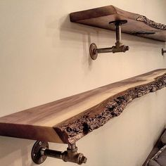 Another shot of the live edge black walnut shelves we made for a repeat client in Toronto. We supplied the finished wood and he made up the brackets. The shelves were made from a nice slab we split in half - the bark was retained as the client preferred it that way. Satin polyurethane finishes off the look. #liveedge #liveedgeslab #liveedgewalnut #blackwalnut #barnboard #barnwood #barn #reclaimed #reclaimedwood #rustic #rusticwood #igers #oneofakind #toronto #hamilton #hamont #tdot #the6i...