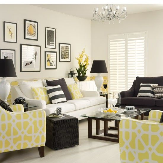 Go for a smart, tailored look in the living room, mixing black and white with accents of fresh color to lighten the look. I would do a light teal instead of yellow.