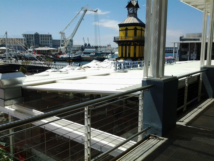 Corradi installation of 6 retractable roof awnings for Cape Town Fish Market Restaurant on the Victoria and Alfred Waterfront in Cape Town.