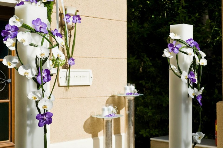Simpl elegant wedding candles decorated with flowers to match your theme