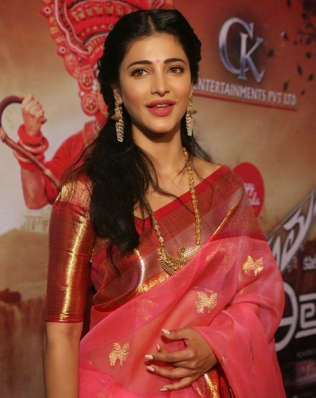 #ShruthiHasan is looking ravishing in the red coloured siken wonder of a saree. At #Shatika we admire young ladies who love to wear sarees. #Shatikasummersale #Handloomsaree #Bollywood