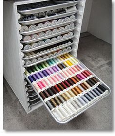 Do-it-yourself thread cabinet. This is a great idea for those of us with tons of thread:); Directions are in Studio magazine, but it's $14. I think I could do this to fit my space.