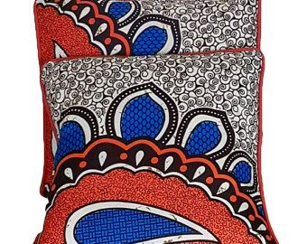 This lisiting is for a Lovely and colourful 16 x16 inch cushion cover with piping. It is made from 100% African wax. The cushion cover is envelope - backed making changing easy. The colours in this cushion cover will give a new look to your home.