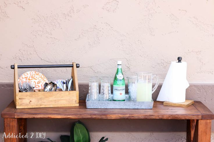 Get your spring entertaining off to the right start with this step by step tutorial to build a rustic industrial dinnerware caddy and paper towel holder!
