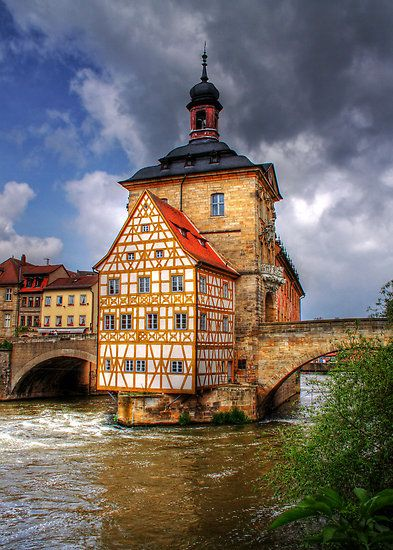 Bamberg's old, half-timbered City Hall was built on an island in the Regnitz River to avoid taxes. The small city is located in the Upper Franconia region of Bavaria – Germany.