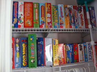 Board game organization, sideways. Best idea ever! It fits so many more!
