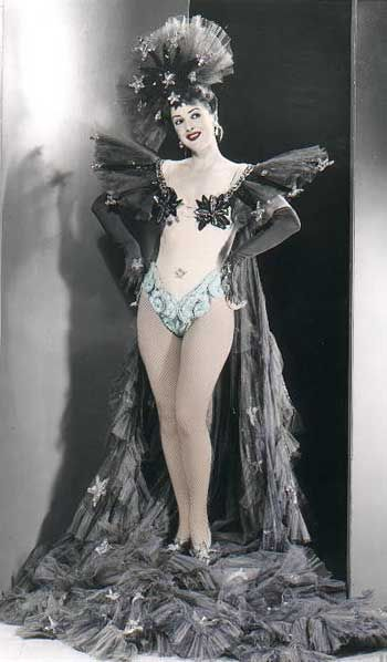 """Gypsy Rose Lee (January1911 - April 1970) was an American burlesque entertainer legendary for her classy, witty striptease act. Her casual strip style as opposed to the herky-jerky styles of most burlesque strippers emphasized the """"tease"""" in """"striptease"""" and she brought a sharp sense of humor to her act as well.   She was also an actress, author, and playwright. (Excerpts from Wikipedia)   """"God is love, but get it in writing.""""  Gypsy Rose Lee"""