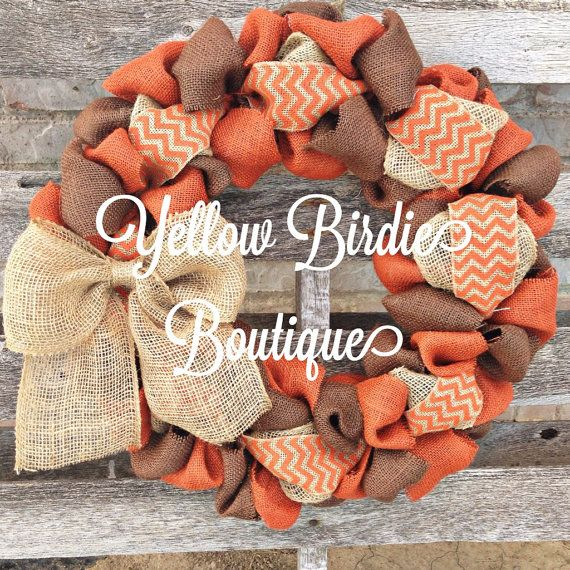 This is a beautiful fall burlap wreath. It is made of burnt orange and chocolate brown burlap with natural and orange chevron through the