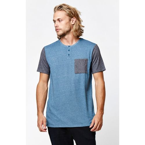 On The Byas promotes a basic look with this comfortable men's tee. The Totem Henley Crew T-Shirt offers a two tone heather look with contrasting chest pocket and three button henley neck. Two tone heather teeChest pocketThree button henley neckShort sleevesMachine washable50% cotton, 50% polyester