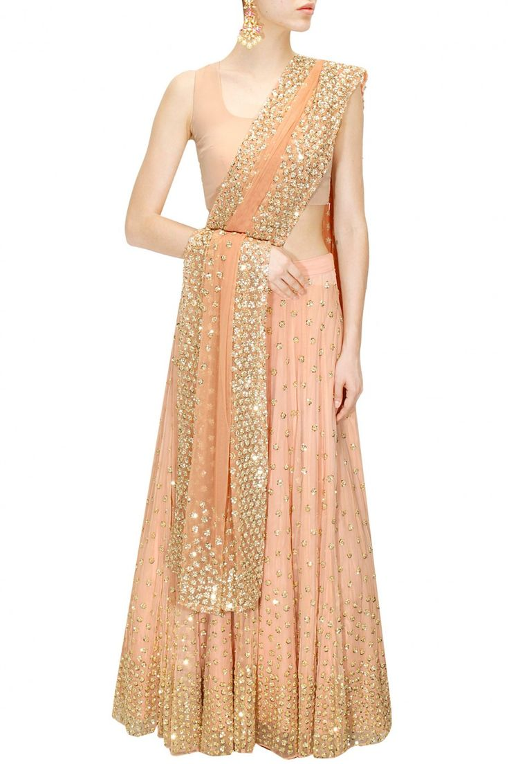 ASTHA NARANG Peach shimmer lehenga set available only at Pernia's Pop-Up Shop.