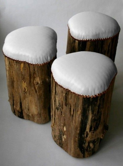 upholstered tree stump stools. brown leather would be awesome. this looks so easy- it's just those big upholstery thumbtacks, a piece of fabric and a block of foam cushion stuff...