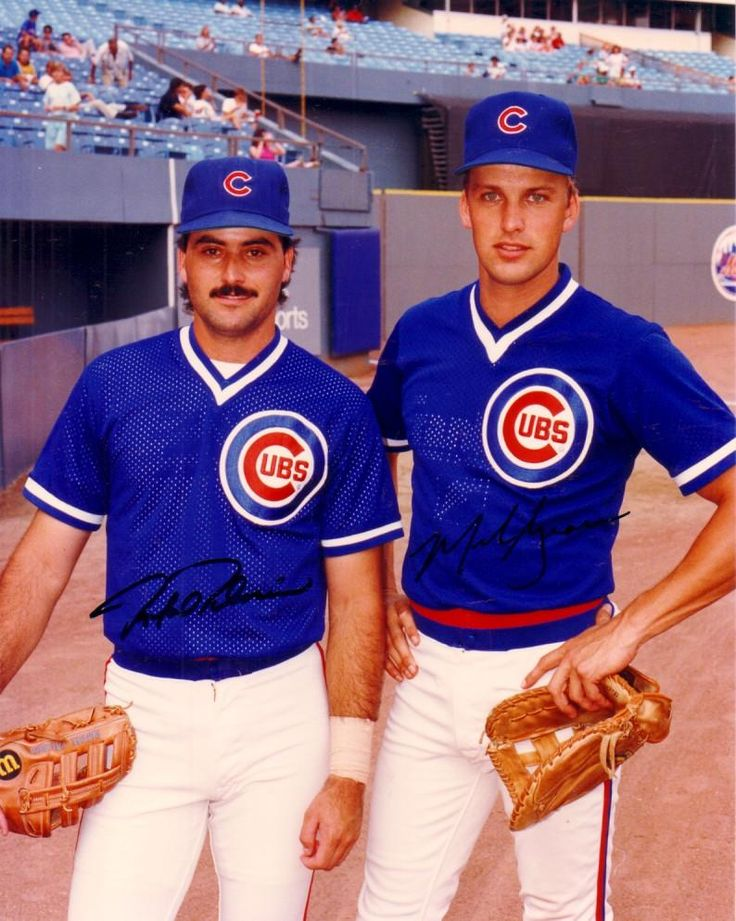 """Mark Grace and... Rafael Palmeiro?!?!?!? A lot of people forget that Palmeiro came up through the Cubs system, and first played with our favorite team. One wonders what would have happened if the Cubs had kept him, instead of through him into the trade that brought Mitch Williams to the team. Maybe Grace could have kept him off the """"juice..."""""""