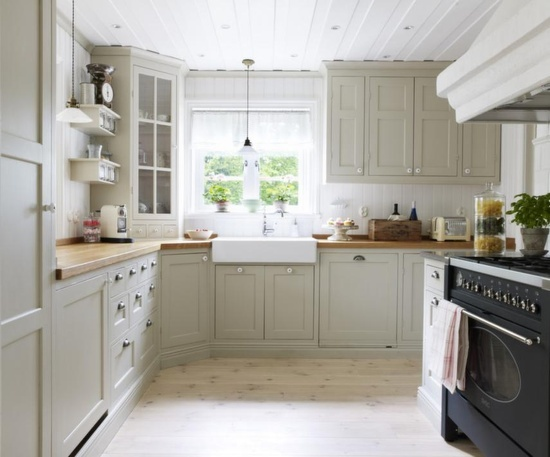light wood floors + light gray cabinets + farmhouse apron sink