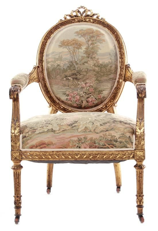 Louis XVI style acanthus-carved giltwood armchair...