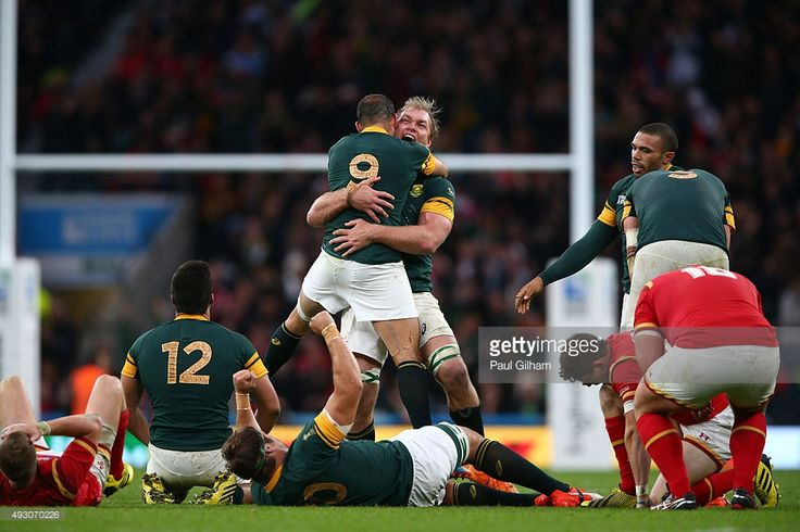 Schalk Burger of South Africa hugs Fourie Du Preez of South Africa as the match ends and SDouth Africa win during the 2015 Rugby World Cup Quarter Final match between South Africa and Wales at Twickenham Stadium on October 17, 2015 in London, United Kingdom.