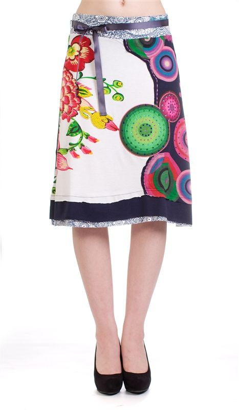 Desigual White Irenia a line skirt  Desigual has been long known for their use of bright colors and the sexy Spanish style that is seen on all of their clothes. Their skirts are a customer favorite. 50% cotton and 50% viscose.