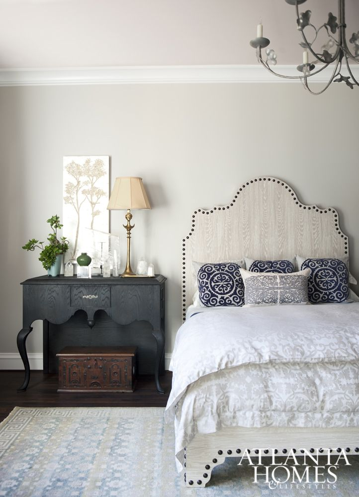 Using English-style architecture as the jumping point for her design, Tish Mills cultivated a soft and transitional guest suite that's as eye-catching as it is serene.