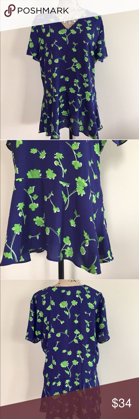 "NWT Banana Republic floral peplum top NWT rich sapphire blue medium weight chiffon top with clover green floral print. Peplum style hem, short sleeves, v neck. Invisible side zip. Size L. 100% polyester. Machine wash. Approx measurements, bust 22"", length 29"".  ⭐️ Banana Republic Tops Blouses"