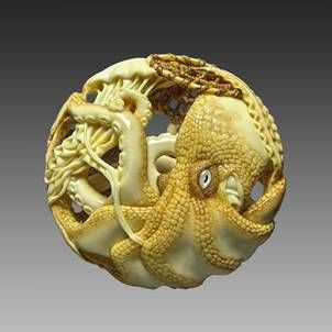 Ama and Octopus, Ryusa-style netsuke, 2011. Carved from mammoth tusk and stained with Yashabushi, Urushi lacquer, Mother-of-pearl and black buffalo horn inlaid eye on octopus. 5.5 cm across, 2 cm thick