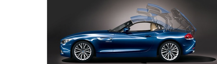 I saw this once at the airport in Germany... It has serious drool factor. BMW Z4 Roadster : Retractable hardtop