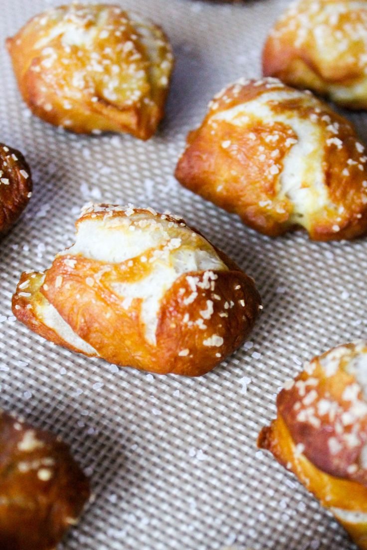 Homemade soft pretzel bites with beer cheese sauce. This recipe isn't hard to make and is the perfect pair with a warm and melty cheese. Serve it at your tailgates or for a family party!