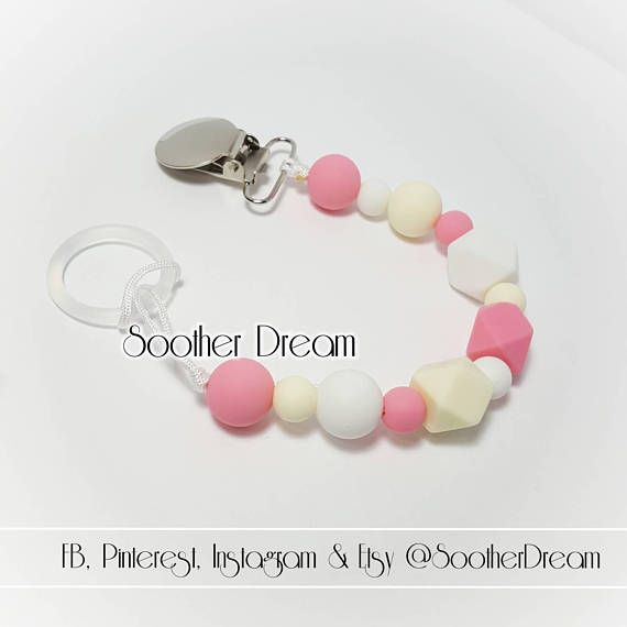Check out this item in my Etsy shop https://www.etsy.com/ca/listing/250488169/silicon-personalized-soother-chain