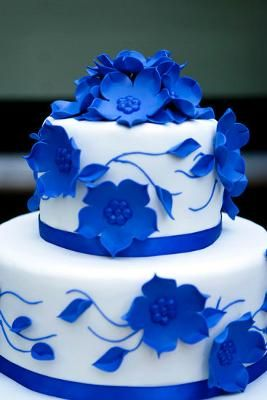 I made this dramatic blue wedding cake by doing flowers out of blue gumpaste and then piped the centers in with royal icing. The cake was covered in white