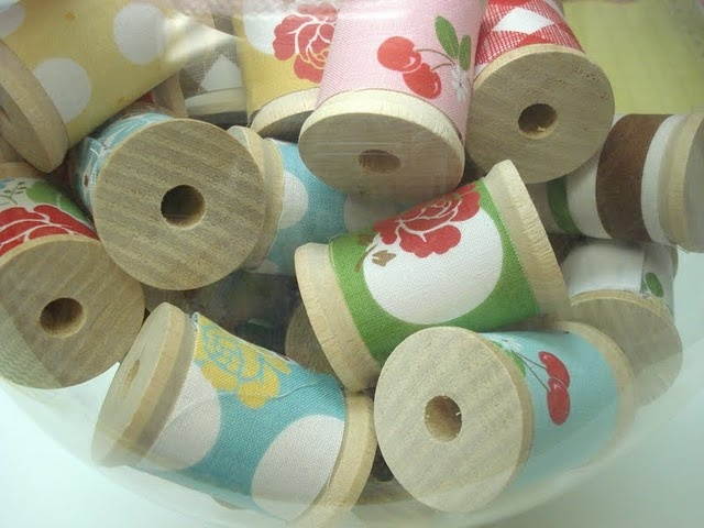 Fabric covered spools tutorial. How cute would these be in a vintage inspired girl's room? Also a fun stacking toy, no?