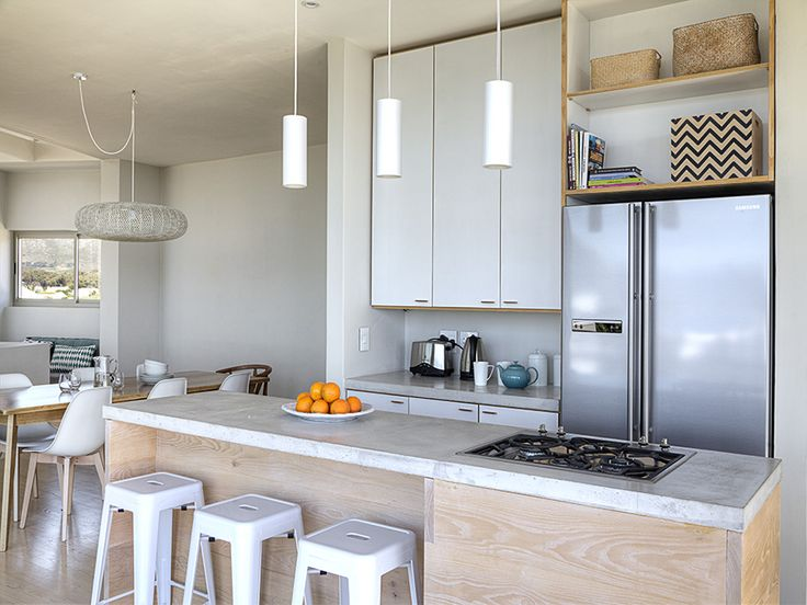 Simple elegance - spacious and neutral. The large island adds weight and plenty of prep space.