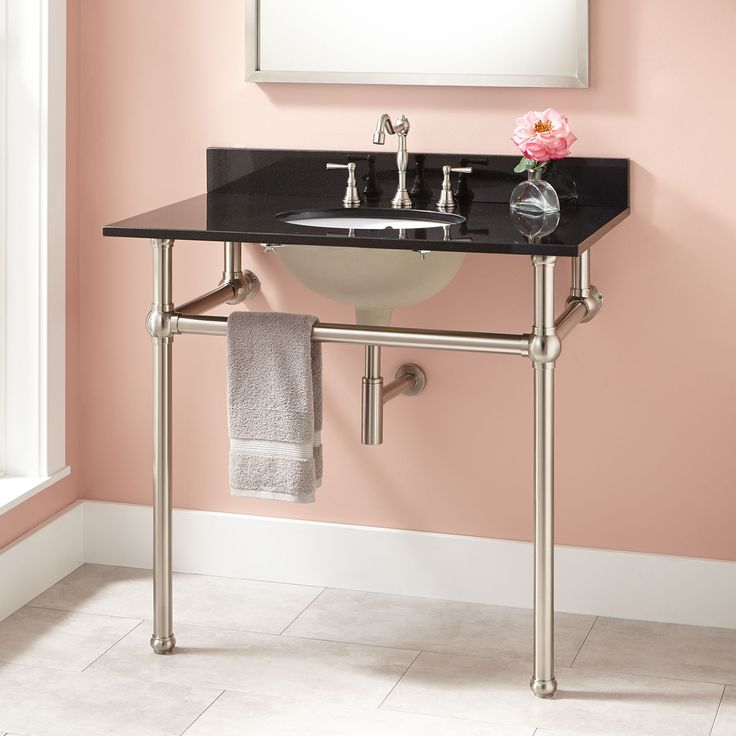 Sink features sturdy legs and a supporting center bar which is perfect for  hanging towels A. Bathroom Item Beginning With K