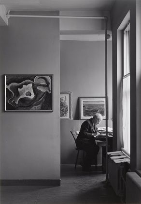 Alfred Stieglitz at his desk at An American Place. 1938. Photographed by Ansel Adams.