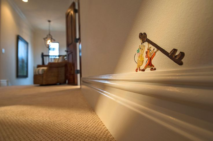 Here, a detail on the home's baseboard from the classic Cinderella.