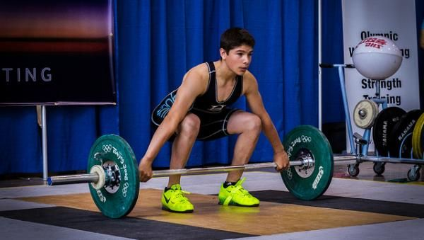 With the popularity of CrossFit and its use of Olympic lifting in its routines, we are also seeing a rise in people interested in entering an official weightlifting event. In addition to CrossFit, many other sports are now using the Olympic lifts as training aids. All of this has led to the revitalization of weightlifting competitions. weightlifting, competition, novice, beginner, referee, loading