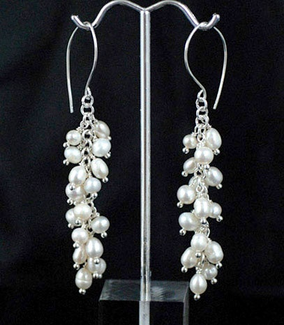 L'Aria Freshwater pearl Earrings. A beautiful slender tapered waterfall of white freshwater pearls.