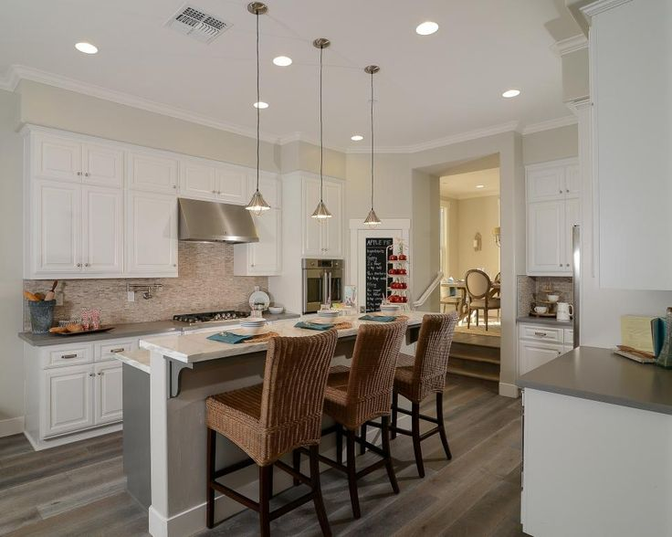 white kitchen cabinets beige walls beige walls white cabinets and stainless steel appliances 28690