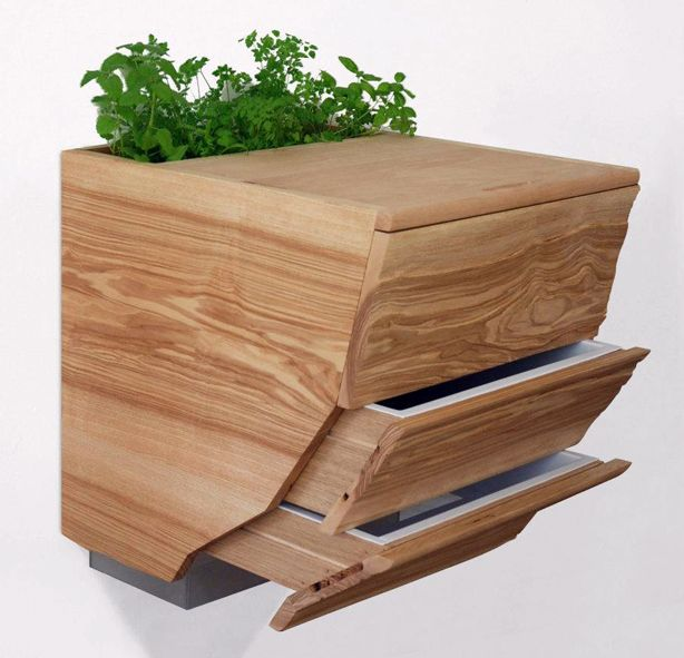 jardin-jardin:  combo cutting board/planter/worm composter.  Not sure I could handle having this in the kitchen, but....