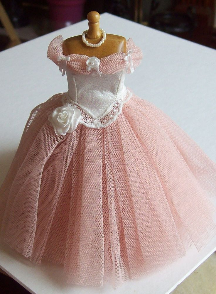 Handmade 1/12 scale dollhouse miniature peachy/pink net and ivory silk gown on mannequin.