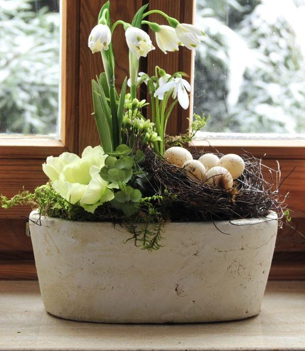 Frühlingsdeko Wohnung ideen zement pflanzenkübel osternest