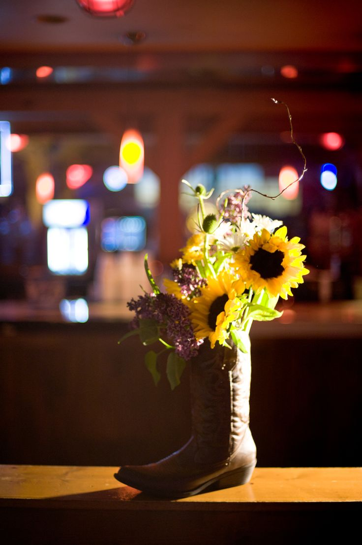 Nashville inspired centerpiece with sunflowers in a cowboy boot. So simple ... yet so fitting.