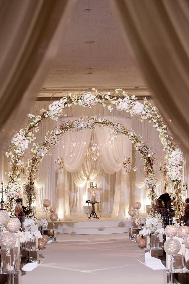 Beautiful archways welcome a bride down the aisle
