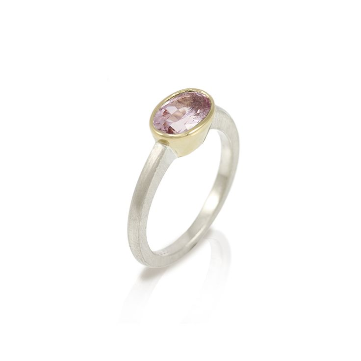 Nefertiti morganite engagement ring  Hand-made in 9 carat white gold and 18 carat yellow gold, with oval faceted Morganite solitaire (8×6 mm).