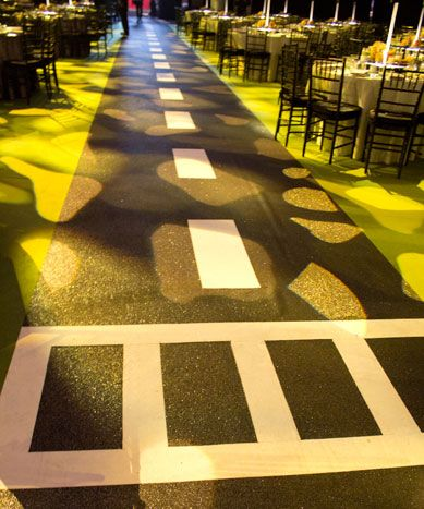 """Befitting the Times Square theme, the aisles between dinner tables were designed like New York city streets, with glittery """"asphalt"""" and roa... Photo: Nadia Chaudhury/BizBash"""