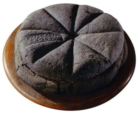 A loaf of bread made in the first century AD, which was discovered at Pompeii, preserved for centuries in the volcanic ashes of Mount Vesuvius. The markings visible on the top are made from a Roman bread stamp, which bakeries were required to use in order to mark the source of the loaves.