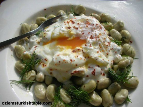 Broad (fava) beans salad with poached egg and garlic yoghurt; packed ...