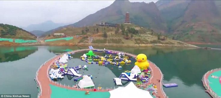 The walkway is supported by more than 200,000 floating objects - including a gigantic cartoon duck - which are anchored to the bed of the river